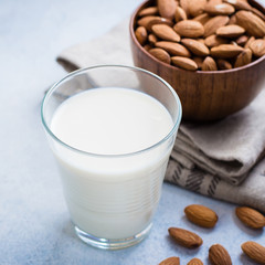 Vegan Nut Milk. Almond Milk in glass and bowl with nuts. Copy space