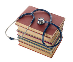 Stethoscope resting on old books.