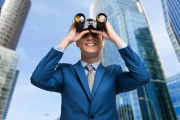 Man watching through binoculars