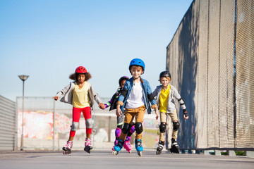 Cute kids on roller skates riding outdoors