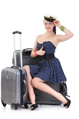 Young woman traveling to vacation with suitcase