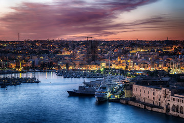 Malta: Manoel Island, Il-Gzira and Marsans Harbour. Aerial view from city walls of Valletta at sunset