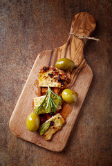 Roasted pork with olive pesto and green olives