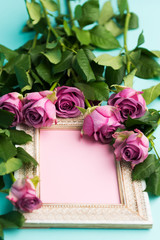 Happy Mother's Day, Women's Day, Valentine's Day or Birthday Background. Greeting card with beautiful wooden vintage picture frame, fresh pink roses and copy space.