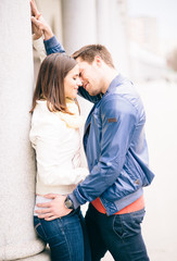 Young couple in love kissing on street