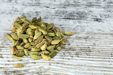 cardamom seeds on a white table