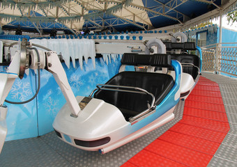 The Seats and Carriage of a Fast Spinning Fun Fair Ride.