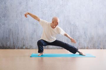 man praticing tai chi chuan in the gym. Chinese management skill Qi's energy. WU-SHU.