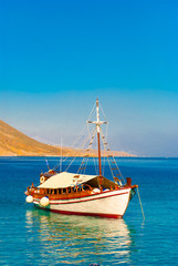 A traditional wooden boat sailing in south Crete of Greece near villages Loutro and Sfakia