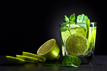 Cocktail with lime , ice  and peppermint .