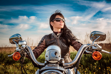 Fototapete - Biker girl sitting on motorcycle