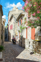 Parked motor in a street  of the village Viviers in the Ardeche region of France