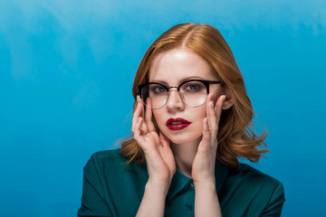 woman in glasses,woman on a blue background