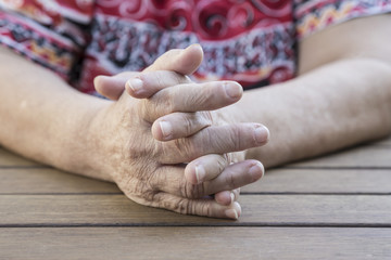 wrinkled hands of an old woman