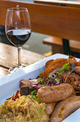 German sausages with meat, vegetables and sauerkraut, cabbage