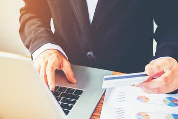 Man hand holding  credit card using keyboard laptop  online banking.  shopping online