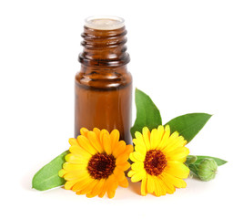 aromatherapy essential oil with marigold flowers isolated white background
