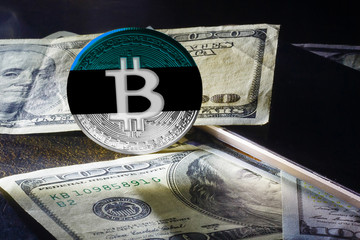 bitcoin dollars on a black background Golden bitcoins with the spotlight