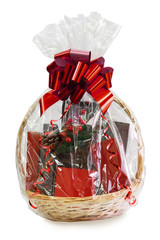 gift basket packed in transparent paper with a big red bow isolated on a white background