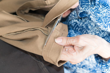 sewing elderly person