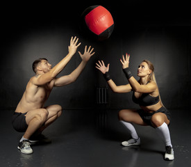 Couple working out with medicine ball