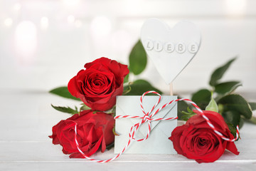 Red roses with a message of love