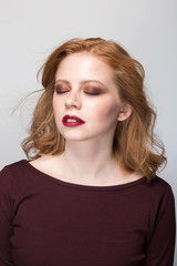 Sensual portrait of redheaded woman with closed eyes