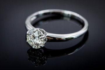 Diamond ring for wedding and engagement on gradient black background