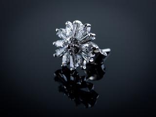 Shiny diamond on reflective surface, gradient lighting style