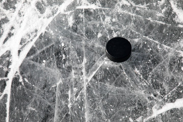 Hockey puck on ice of a frozen pond in Colorado