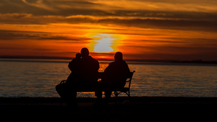 People silhouette on the sunset light near the lake Balaton in Hungary