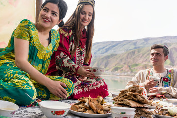 Friends in Tajikistan eating in traditional restaurant