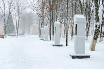 Heavy snowfall, snow-covered park in town Vetka, Gomel region, Belarus