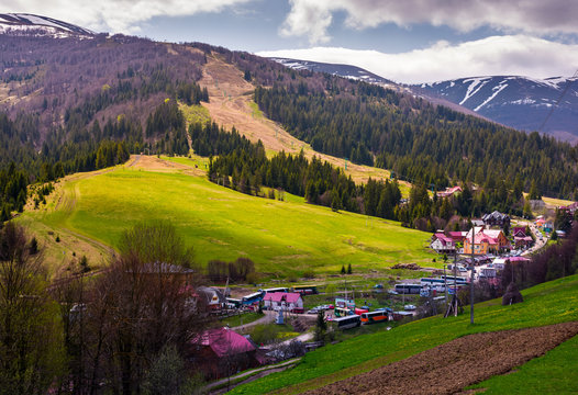 Pylypets, Ukraine - May 01, 2017: Tourist buses in Pylypets resort village. beautiful springtime landscape in Carpathian mountains