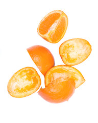 Fresh organic cut into quarters and eaten mandarins fruit isolated on white background