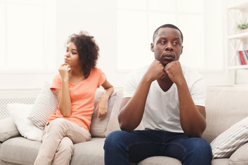 Young black couple quarreling at home