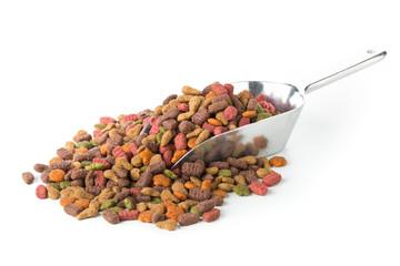 Heap of dry pet food in metal scoop