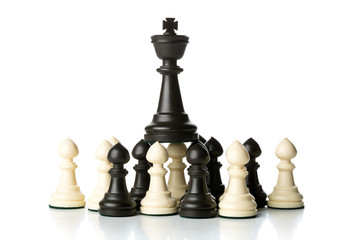 King chess figure on top of pawn chess figures
