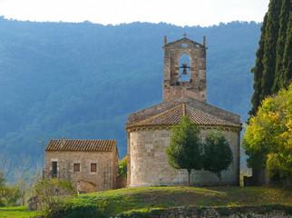 Romanesque church Santa Maria de Porqueres and an old stone house, Porqueras, Pla de l'Estany, Catalonia, Spain