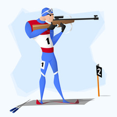 A biathlete standing with a rifle