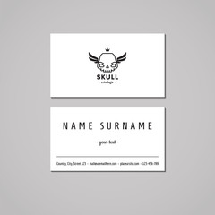 Business card hipster style with skull logo and wings (vector).