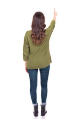 Back view of a young girl pointing, isolated on a white background