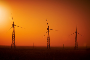 Wind power generation, Wind turbines on farmland with sunset