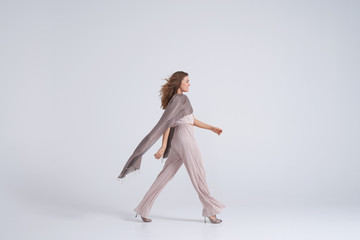 Woman wearing trend clothing and silk scarf walking