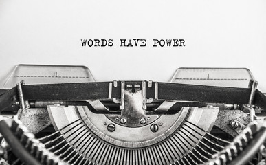 Words Have Power typed words on a vintage typewriter in monochrome. Close up
