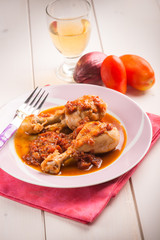 chicken leg with tomato sauce, selective focus
