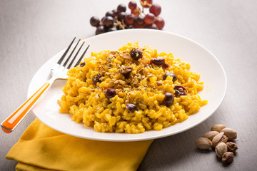 risotto with saffron grape and pistachio nut, selective focus