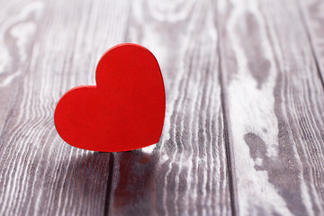 Valentines Day background with heart over wooden table