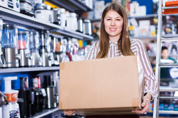 Girl holding box with purchase