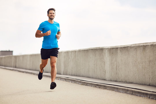 Athletic young man running